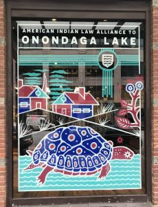 Patagonia window art in support of Onondaga Lake