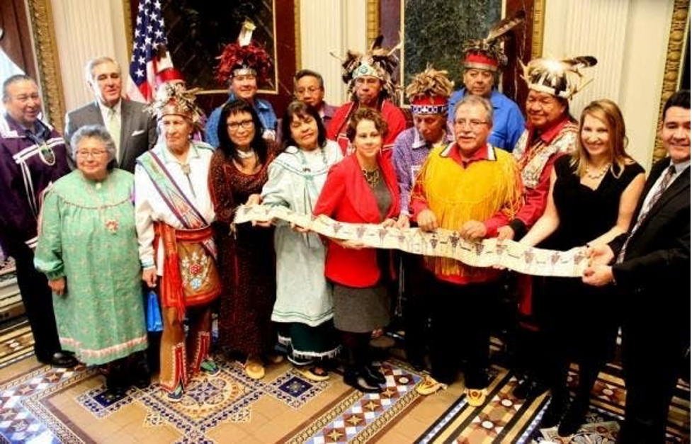 Haudenosaunee Nation leaders, clan mothers and U.S. Government officials hold the belt George Washington had made and had presented to the Haudenosaunee in 1794 at the Canandaigua Treaty. Feb 25, 2016